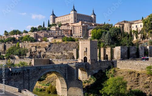 Morning at Toledo - Panoramic morning view of historic city Toledo at Puente de Alcántara, a Roman arch bridge at front of east city gate Puerta de Alcántara and over Tagus River Canvas Print
