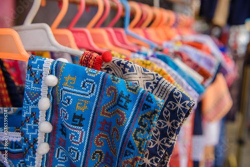 Obraz na plátně Native coat of many colors in market