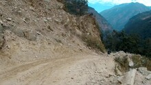 PAN Hiking Alond Dirt Road In Remote Mountains In Nepal