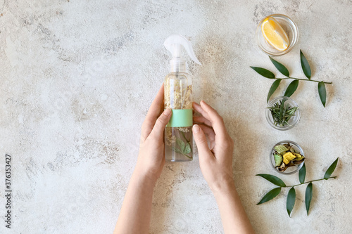 Woman with natural homemade air freshener at table Canvas