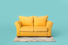 Stylish Sofa And Carpet On Col...