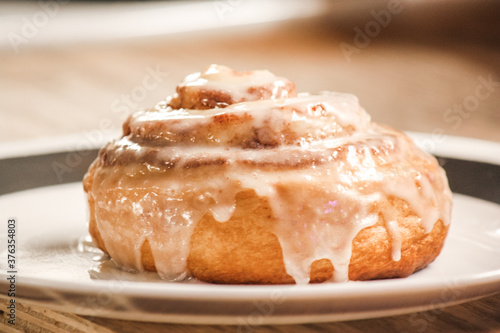 Delicious hot cinnamon roll with icing Canvas Print
