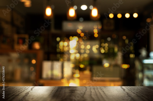 top of black table with blur light in pub or bar party night life background Fotobehang