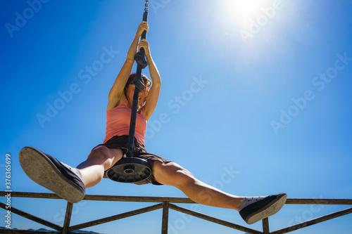 Fotografia Adult woman having fun on zipline