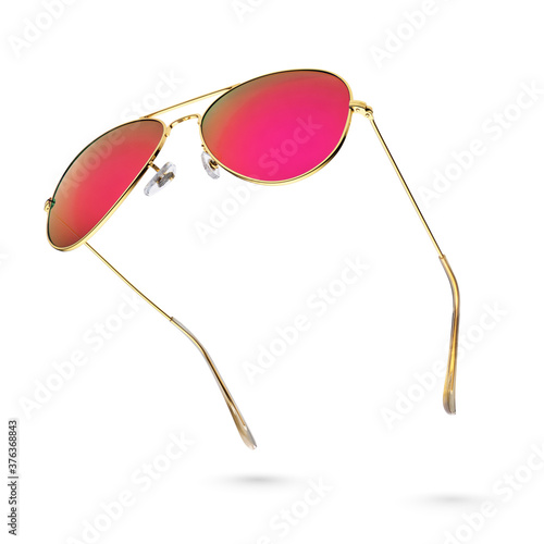 Canvas Pink aviator sunglasses with golden frame isolated on white.
