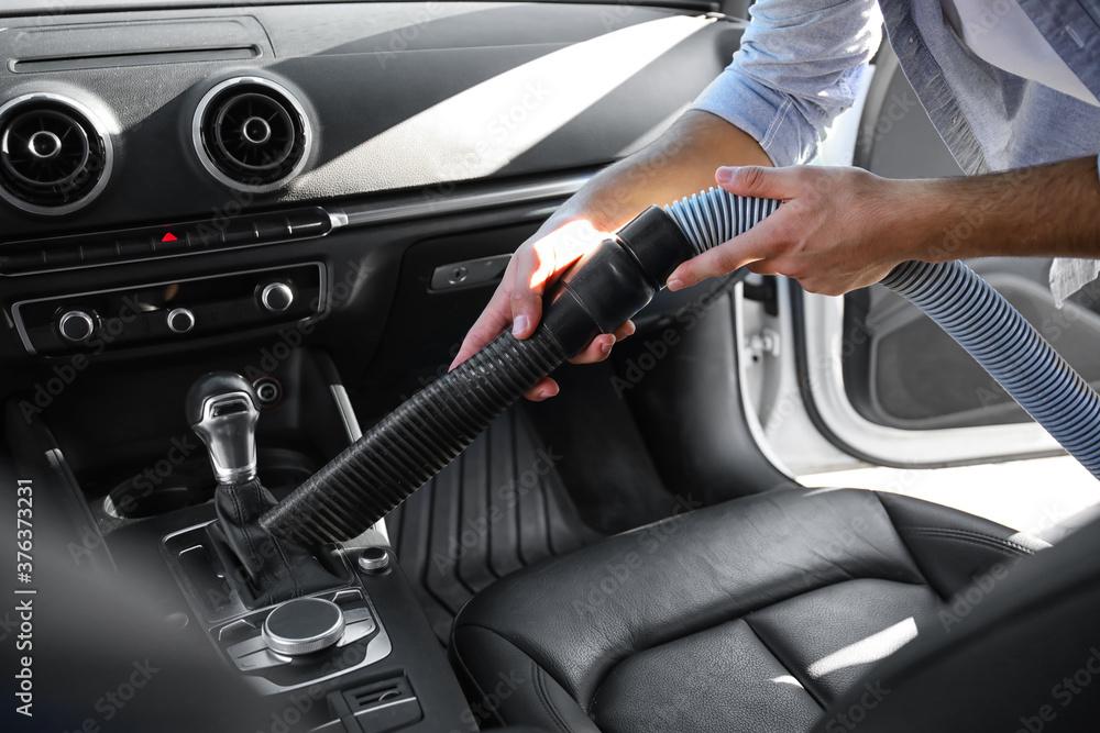 Fototapeta Man cleaning his car inside