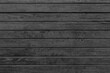 Horizontal black wood background. Old dark wooden background with black wood texture. Dark wood texture panel with horizontal planks.