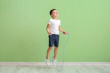 Cute Little Boy Jumping Rope N...
