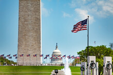 WWII And Washington Memorial Obelisk Column Over Flags, US Capitol Building, DC, USA