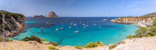Fotografie, Obraz Beautiful Panorama of bay Cala Hort with sea sailing yachts and the mountain Es Vedra