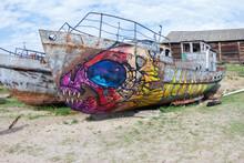 Graffiti On An Old Rusty Ship
