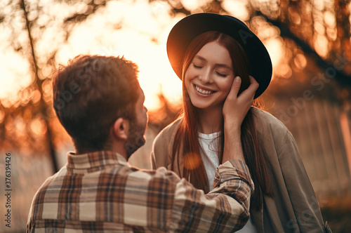 Couple in park in autumn Poster Mural XXL