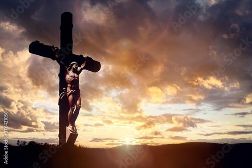 Obraz na plátne Crucifix cross at sunset background, crucifixion of Jesus Christ