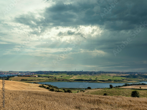 rural landscape with blue sky and clouds Canvas Print
