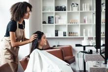 Young Woman Looking For Changes, Trying New Hairstyle At Beauty Salon
