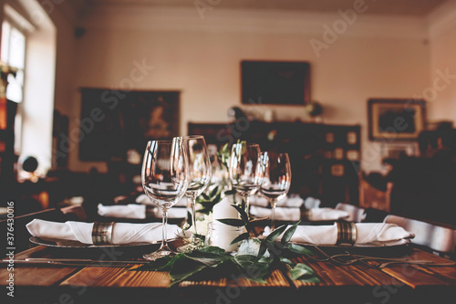 Wedding banquet, serving wooden table with silver plates and decorated with flow Fototapet