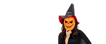 Asian Woman Wearing Halloween Costume As Witch In Black Cloak, On White Background, Wearing Orange Pumpkin Mask, Looking At Camera