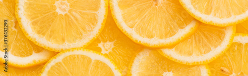 Papel de parede top view of sliced fresh and ripe yellow lemons, panoramic shot