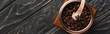 Top View Of Vintage Coffee Grinder With Coffee Beans On Wooden Surface, Panoramic Shot