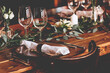 canvas print picture - Wedding banquet, serving wooden table with silver plates and decorated with flowers