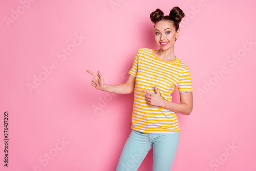 Tela Photo of attractive charming lady two buns hold arms direct fingers side empty s
