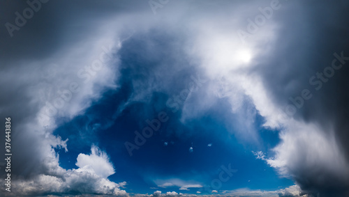 Fototapeta Blue fantastic sky with clouds and sunshine (wide natural cloudscape background