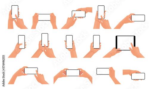 Fotografie, Tablou Big set of hands holding the black smartphone with blank screen and modern frameless design