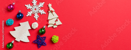 Top view Banner of holiday decorations and toys on red background. Christmas ornament concept with empty space for your design