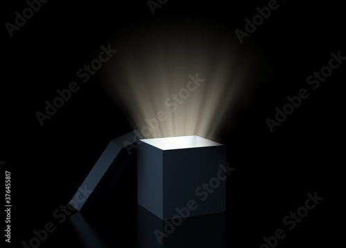 Obraz Magic box with glowing light over black background, exploration, idea or discovery concept - fototapety do salonu