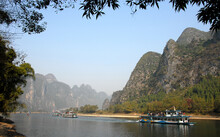 Boats On The Li River Between Guilin And Yangshuo In Guangxi Province, China. The Karst Hills And River Scenery Have Provided Inspiration For Artists And Poets. Li River Scenery, Guilin.