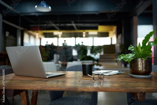 Fototapeta Items sitting on a desk in an office after work obraz