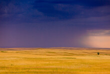Rolling Plains Against A Dark Stormy Sky In The Badlands, South Dakota
