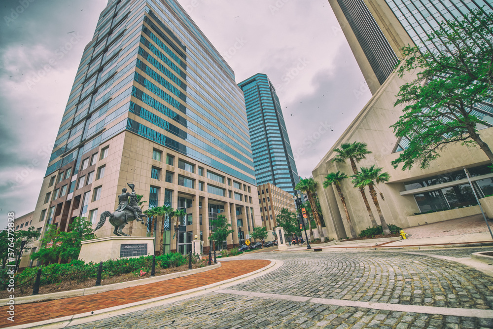 Fototapeta JACKSONVILLE, FL - APRIL 8, 2018: City skyscrapers from independent Drive on a cloudy day