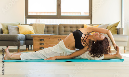 young pretty woman practising yoga indoor Fototapet