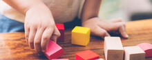 Closeup Hand Of Boy Playing Wooden Block Toy On Table For Creative With Enjoy, Happy Child Learn Skill For Activity Puzzle And Creativity For Game On Desk At Home, Education Concept, Banner Website.