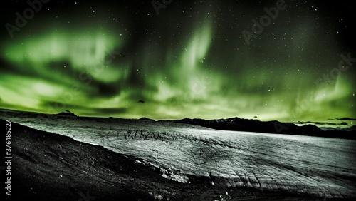Fototapeta aurora borealis over the glacier