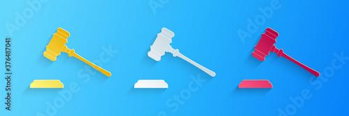 Fototapeta Paper cut Judge gavel icon isolated on blue background