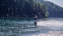 Little Boy Wake Boarding Behind Motorboat