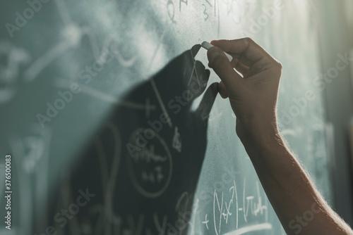 Professor writing mathematical formulas on the chalkboard Wallpaper Mural