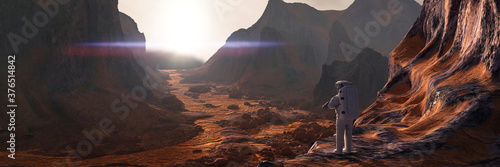 Fotografia astronaut on planet Mars watching the rising Sun
