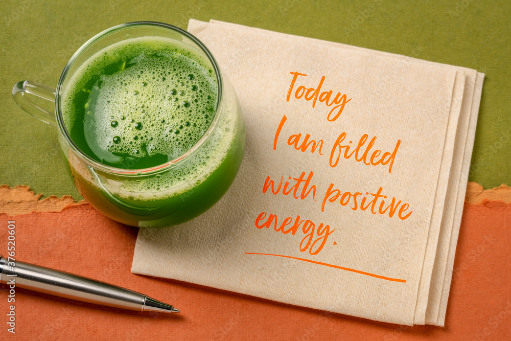 Fototapeta today I am filled with a positive energy - inspirational note on a napkin with a glass of fresh green cucumber juice, lifestyle and positivity concept