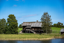 Vintage Wooden Complex With Temple Watchtower And Fortress Wall Against Blue Sky