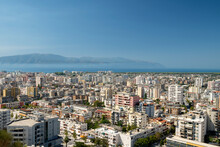 Albania, Vlore, Cityscape Seen From Kuzum Baba Hill. Aerial City View, City Panorama Of Vlore With The Monument Of The Partisans