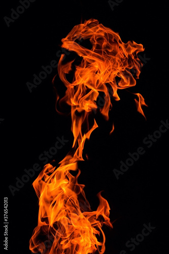Bright orange red Fire flame against black background, abstract texture Wallpaper Mural