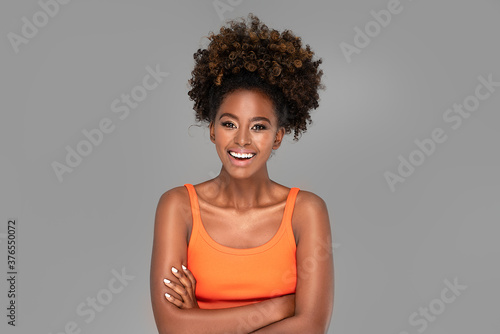 Beautiful happy afro woman smiling to the camera. Canvas Print