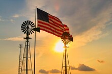 Windmill And American Flag At Sunset