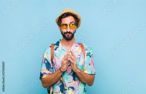 young bearded tourist man scheming and conspiring, thinking devious tricks and c Canvas Print