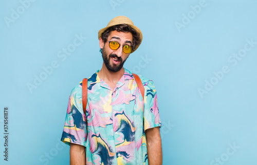 young bearded tourist man feeling puzzled and confused, with a dumb, stunned exp Canvas Print