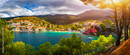 Fototapety, obrazy: Turquoise colored bay in Mediterranean sea with beautiful colorful houses in Assos village in Kefalonia, Greece. Town of Assos with colorful houses on the mediterranean sea, Greece.