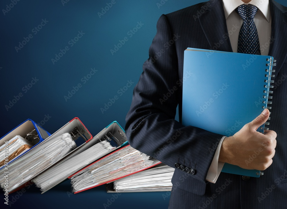 Fototapeta File folders with documents and business man